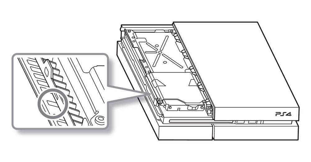 Localiza el tornillo de extracción de disco de la PS4