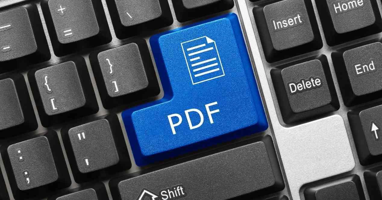 Teclado con la tecla enter que lleva el icono de un archivo y PDF incluidos